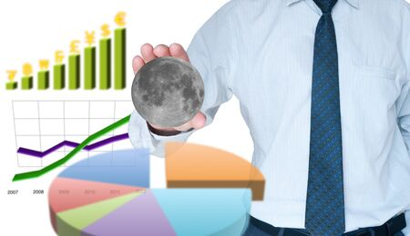 Businessman capture the moon with business graph background Stock Photo - 10449248