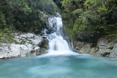 a small waterfall at Milford Sound, New Zealand