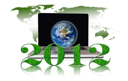 Year 2012 with Laptop and earth photo