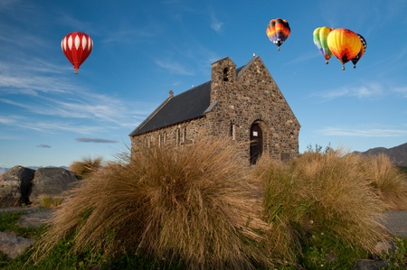 tekapo: Moon and Hot air ballloon over  Church of the Good Shepherd, Lake Tekapo, New Zealand Stock Photo