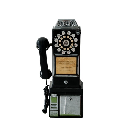 ancient telephone: An old vintage pay phone isolated over white Stock Photo