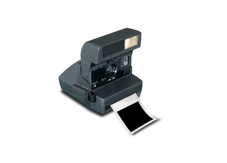 Retro camera with blank picture frame isolate on white photo