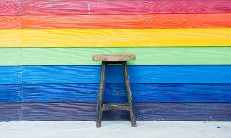 Multi color wooden wall with old chair