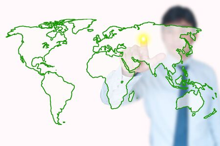 plotting: Businessman is plotting points on a map of the Earth Stock Photo