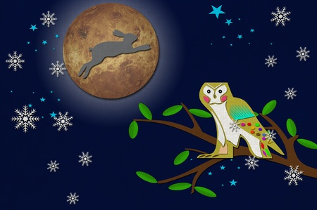 Rabbit on the moon with owl on tree  from recycled papercraft photo