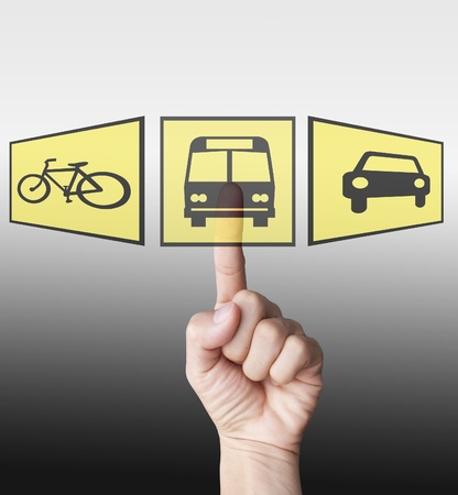 Hand selecting on hi technology bus icon over car and bus icon Stock Photo - 10714838