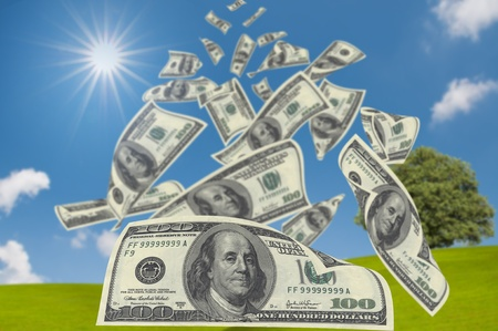 federal states: 100 US Dollars falling from sky Stock Photo