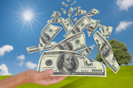 money tree: Hand get money falling from sky Stock Photo