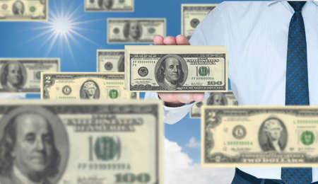 Businessman holding stack of 100 dollars Stock Photo - 10785298