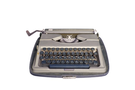 Old dirty Retro typewriter with clipping path isolated on white photo