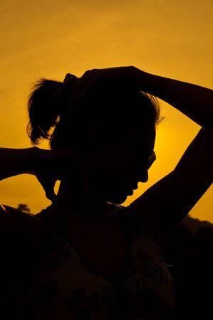 strand of hair: Girl in Silhouette sexy action Stock Photo