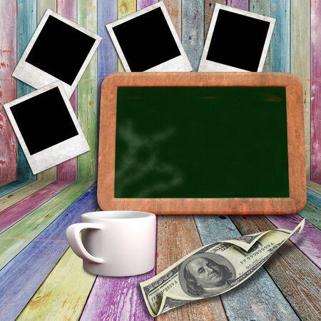 Blackboard and coffee mug on vivid wooden shelves photo