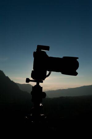 Silhouette of DSLR camera photo