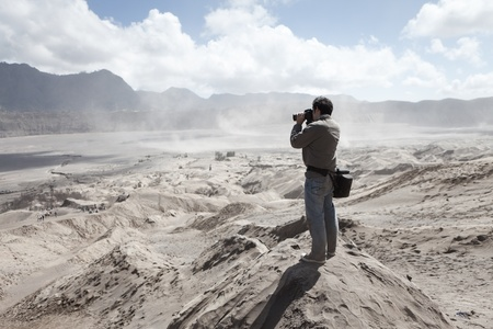 Man standing againt Gunung Bromo photo