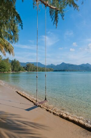 Beautiful Thailand beach with the swing Stock Photo - 11291287