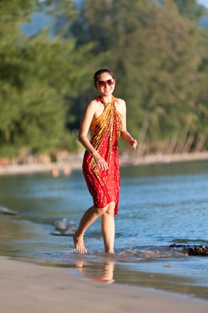 Beautiful asian girl enjoying at the beach photo