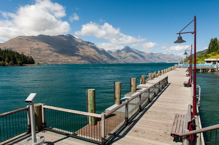 Wooden pier at Wakatipu lake, New zealand photo