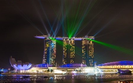 marina bay sand: SINGAPORE -DEC 25  Beautiful lasor show at the Marina Bay waterfront in Singapore  Wonder Full lasor show and water spectacular in Southeast Asia Editorial