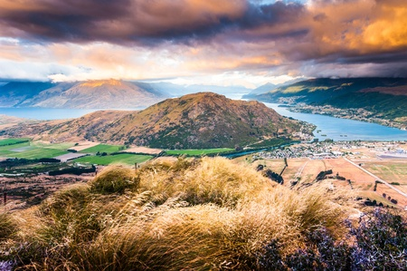 Aerial view of Queenstown with lake Wakatipu at dusk in panorama photo