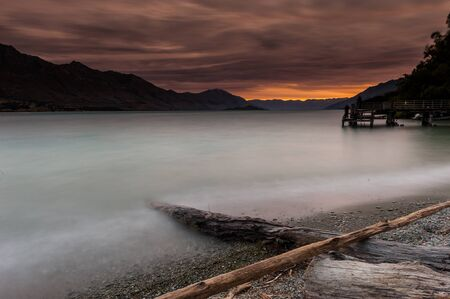 Red sky with wooden pier photo