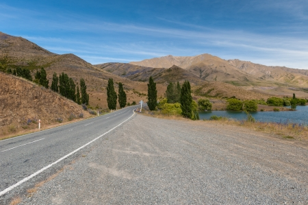 foothill: Winding Road along the lake Stock Photo