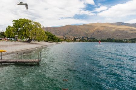 Beautiful scenery of wooden bridge at Lake Wanaka, New Zealand photo