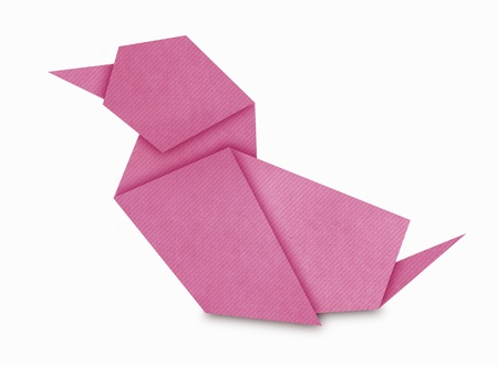 Origami of pink Duck form recycled paper isolated on white photo