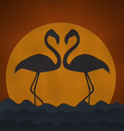 both: Sunset with Flamingo make heart sigh from recycled paper Stock Photo