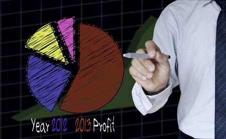 Businessman draw graph for year 2012-2013 photo