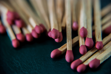 wooden stick: Close-up of wooded matchsticks on dark background.