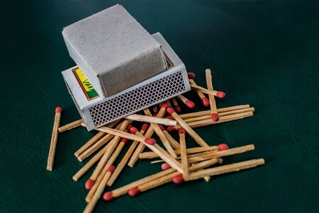 Clutter of wooded matchsticks on dark background. Imagens