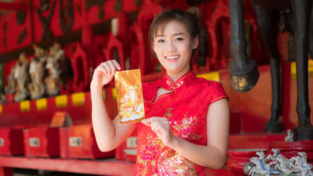 Asian girl in red dress.Chinese New Year.Cheongsam dress