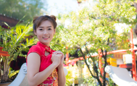 Asian girl in red dress Chinese New Year
