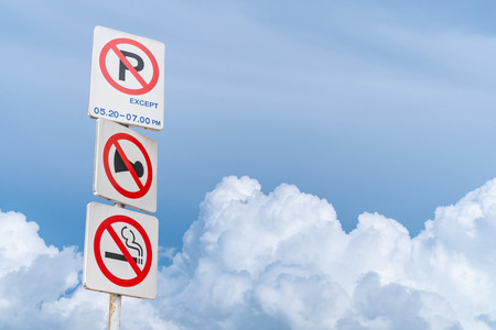 Traffic Signs: All three signs. On the sky background is a beautiful cloud.  Do not park, do not use a horn, do not smoke.