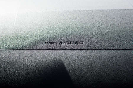 SRS Airbag icon in car. selective focus.