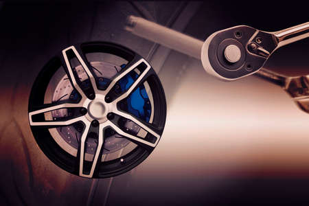 axle: Double exposure. Repairing wheel concept. Wheel of racing car with modify. Clipping path. Stock Photo