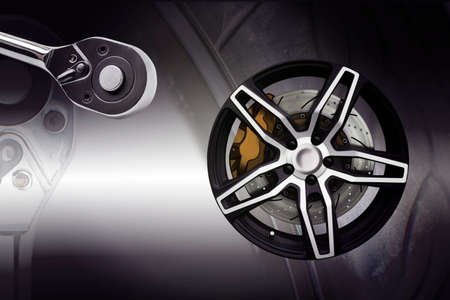 Double exposure. Repairing wheel concept. Wheel of racing car with modify. Clipping path. Stock Photo