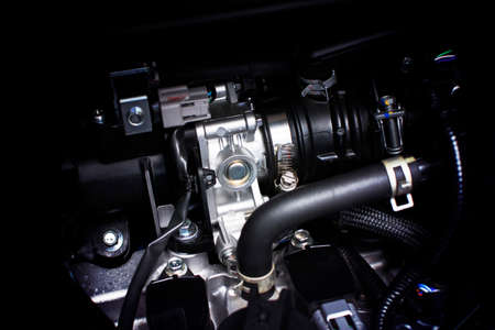 Throttle body installed in gasoline part engine system of car, automotive part concept.