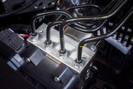 ABS unit module control box with pipes of car brake system.