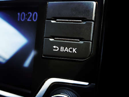 Back button on the head unit multimedia player in the car. Stok Fotoğraf