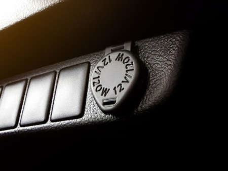 12 Volt power outlet socket and cigarette lighter in the car.