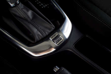 Car sport and comfort mode button switch of automatic gear transmission in a luxury car.