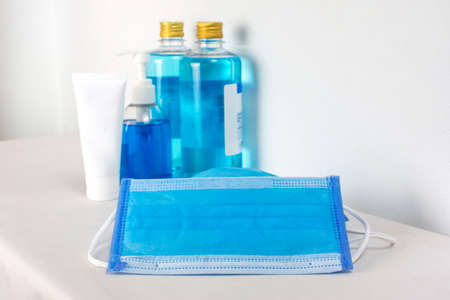 Medical mask and alcohol sanitizer for cleaner sterilize on white table with copy space,Coronavirus,Covid-19 prevent infection.