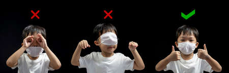How to wearing medical face mask correctly from asian little boy , how to wearing face mask correct and the wrong , Coronavirus prevention (COVID-19) concept