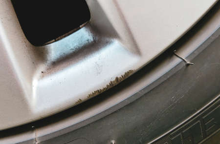 Scratches on the gray alloy wheels of the car