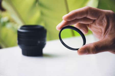 UV filter of camera lens in the hand 版權商用圖片