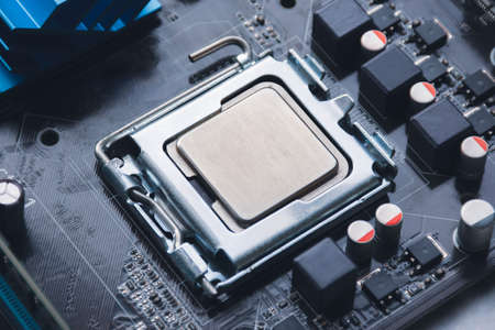 CPU processor chip in socket on computer motherboard