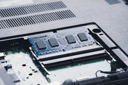RAM (Random-access memory) in memory slot on the motherboard of laptop