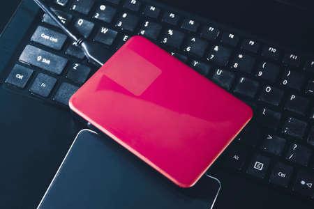 External hard disk 2.5 inch on the laptop keyboard 版權商用圖片