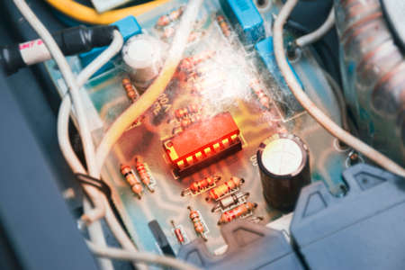 The Integrated circuit (IC) overheats and burns in the socket on the electronic circuit board